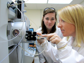 Dr. Edelmann's laboratory assistants use a mass spectrometer to analyze protein samples. Photo credit: MSU