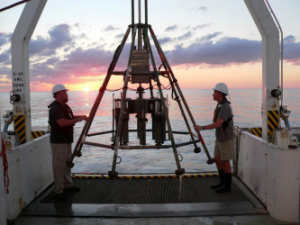 Researchers prepare to deploy a multi-corer which will collect sediment samples from the sea floor.