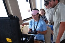 Fairview High School teacher Stephanie Chambers navigates an underwater ROV while out at sea aboard DISL's R/V Alabama-Discovery. (Photo credit: Tina Miller-Way, DISL)