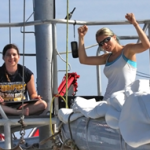 Kait Frasier (L) and Rachel Gottlieb (R) with Scripps Institution of Oceanography onboard the Ocean Alliance's R/V Odyssey in the Gulf of Mexico celebrate after finding dolphins. (Photo provided by Frasier)