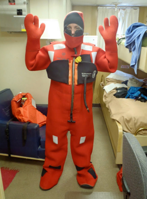 "On NOAA's R/V Gordon Gunter, in the Gulf of Mexico, Kait Frasier dons a survival suit (referred to as a ""Gumby Suit""). Researchers have to be able to get into it in under a minute, which takes some practice. (Photo provided by Frasier)"