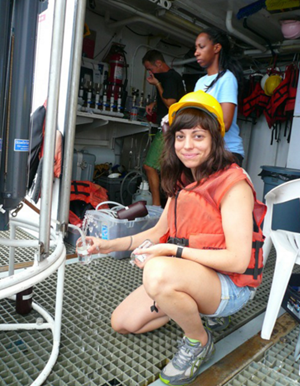 Alex Harper collects seawater samples from CTD Rosette Niskin bottles aboard R/V Weatherbird II. (Photo credit: Natalie Geyers)