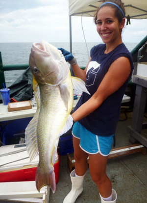 Susan poses with a large golden tilefish. (Photo credit: Liz Herdter)
