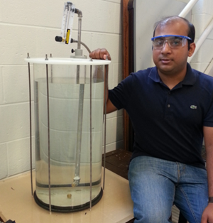 Amitesh Saha displays his setup to study the underwater injection of dispersant on an oil plume. (Provided by Saha)