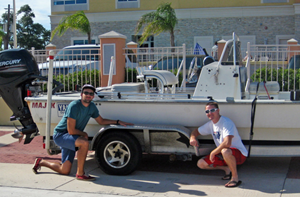 Dave Christiansen (left) and Garrett Kehoe (right) pose with their beloved but shambling boat trailer, which lost two of its four wheels during a data collection trip from Austin to Galveston Bay. (Photo credit: Matt Rayson)