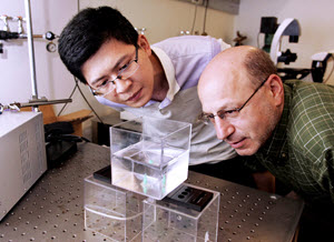 Dr. Howard Stone (right), the Donald R. Dixon '69 and Elizabeth W. Dixon Professor of Mechanical and Aerospace Engineering at Princeton University, and gradute student Jie Feng (left) observe bubbles in a tank. (Photo credit: Frank Wojciechowski, Princeton University)