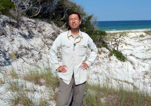 Xuan uses an aspirator to collect ants from coastal dunes in Florida's T.H. Stone Memorial St. Joseph Peninsula State Park. (Photo provided by Xuan Chen)