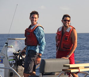 Conor (left) and University of Miami marine specialist Mark Graham (right) prepare to deploy a CTD to measure salinity and temperature profiles near the Deepwater Horizon site. Data from these measurements provide insight into the movement of the ocean surface. (Photo credit: Nathan Laxague)
