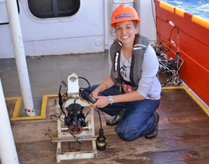Caroline Johansen displays one of her camera systems that was lost for 9 months and found after three days of searching the seafloor. (Photo provided by Johansen and taken by a crew member of the R/V Pelican)
