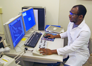 Sehinde conducts room temperature imaging of halloysite nanotubes with magnetic materials on the surface. (Photo by Chike Ezeh)