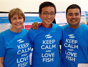 Subham (right) poses with Anne McElroy (left) and a high school summer research fellow, who enjoyed working with Subham and McElroy so much that he created matching t-shirts for the group. (Provided by Anne McElroy)