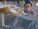 Cheng Li Studies Oil Breakup using a Wave Tank