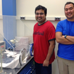 Subham Dasgupta (left) and Irvin Huang (right) used this glove box to create hypoxic conditions for this study.  (Photo provided by Anne E. McElroy)