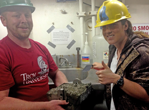 Ceil and lab mate Jonathan Miller display the sediment they collected for their meiofauna research. (Photo courtesy of Ceil Martinec)