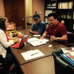 Heather Dippold (left- CONCORDE Education & Outreach) meets with Peter Nguyen ( right close- Mississippi State University Coastal Research and Extension Center) and Captain Nguyen (far right) to discuss data collection and the community meeting. Photo credit: Jessica Kastler