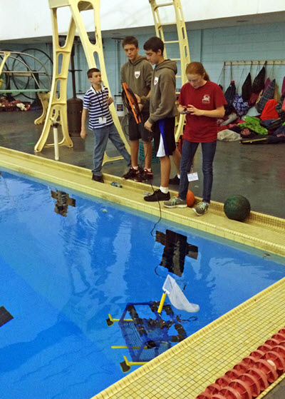 Sacred Heart Cathedral School prepares their ROV for competition. The team later received first place in the Scout Level of competition. (Photo credit: Tracy Ippolito)