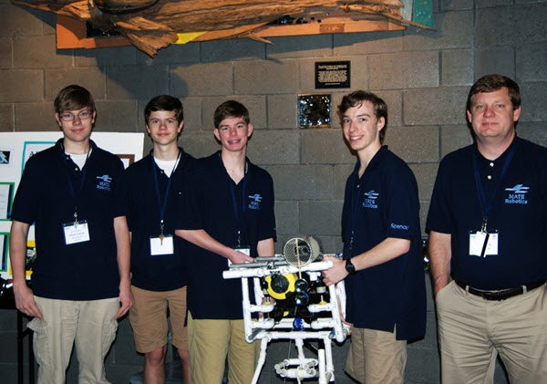 The team from James Clemons High School pose with their ROV. They received first place in the competition's Navigator Level. (Photo credit: Tina Miller-Way)
