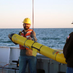 Adam Boyette retrieves a glider on the deck of the R/V Point Sur, where he served as chief scientist on the three-day cruise examining the impacts of the Bonnet Carré spillway opening. (Photo by Alison Deary)