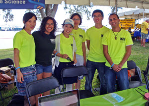 Shaojie (right 2nd) and other USF College of Marine Science students share their research about Ocean Color with the public at the St. Petersburg Science Festival. (Photo by Chuanmin Hu)