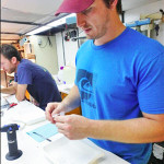 Max removes tissue from a fish for future genetic analysis aboard the RV Point Sur. (Provided by Max Weber)