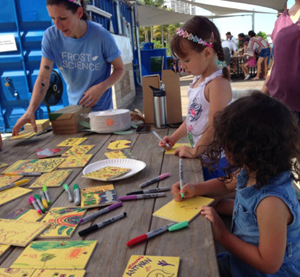 Families worked with Vizcaya Museum and Gardens, Miami Science Barge, and Patricia and Phillip Frost Museum of Science to beautifully paint cards for the Bay Drift study. (Photo by Laura Bracken)