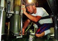 Patrick Schwing measures a sediment core extracted from the Gulf of Mexico seafloor. Photo Credit: Devon Firesinger 2015