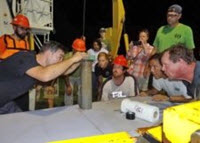 Patrick Schwing and the research crew aboard the RV Justo Sierra prepare a sediment core from the southern Gulf of Mexico for analyses. Photo Credit: Devon Firesinger 2015