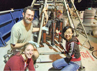 First Author Tingting Yang [right], thesis advisor Andreas Teske [left], and fellow graduate student Lisa Nigro [left] point to the multicorer full of seafloor sediments, onboard R/V Atlantis in the northern Gulf of Mexico, November 2010. Photo provided by Andreas Teske.