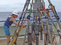 Study author Samantha Joye collects Gulf of Mexico sediment samples using a multi-corer. Photo courtesy of ECOGIG.