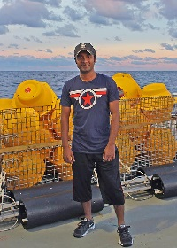 Sakib stands on the deck of the R/V Pelican during LADC-GEMM's 2015 recovery cruise. (Photo by Natalia Sidorovskaia)