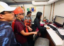 (L-R) Kun Li, Natalia Sidorovskaia, Sakib, and Tingting Tang monitor acoustics signals in the R/V Pelican's dry lab during LADC-GEMM's 2015 recovery cruise. (Photo by Douglas Dugas)