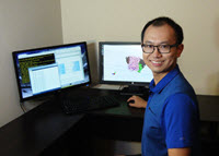 Co-author Zenghui Zhang works with molecular simulations to visualize the interactions of oil compounds with two Corexit surfactants (DOSS, SPAN 80) and their effects on aerosolization. (Photo provided by Zenghui Zhang)