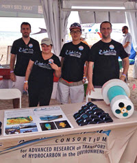 Shitao (center right) volunteered at the CARTHE booth during Rock the Ocean's Tortuga Music Festival in Fort Lauderdale, FL. (Provided by CARTHE)