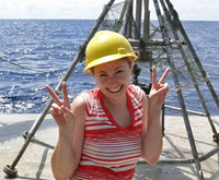 Melissa stands next to the multi-corer used to collect sediment samples. (Photo by Ben Prueitt)