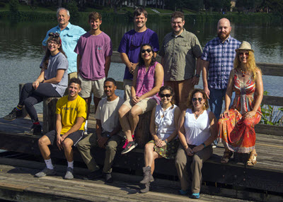 Devika (middle row, center) and Husseneder (middle row, far right) pose for a group photo with their research team. (Photo by Claudia Husseneder)