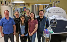 Tesla Petroleomics Centre at the University of Calgary. Bruker SolariX FTICR-MS is shown at the right hand side. From R-L: Dr. Jagos Radovic, Postdoctoral Fellow; Melisa Brown, FTICR-MS analyst; Ryan Snowdon, IT specialist; Aprami Jaggi, PhD student; Dr. Stephen Larter, Professor; Dr. Thomas Oldenburg, Adjunct Professor (Photo credit: Chloe Duong).