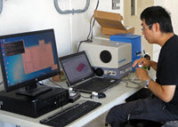 David takes fluorescence measurements to identify the presence of PAHs in his samples. (Provided by David Shi)
