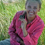 Allison holds a Seaside Sparrow after a muddy day in the field. (Photo credit: Anna Perez-Umphrey)